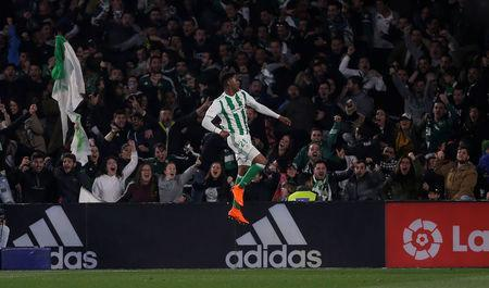 Soccer Football - La Liga Santander - Real Betis vs Real Madrid - Estadio Benito Villamarin, Seville, Spain - February 18, 2018 Real Betis' Junior Firpo celebrates after Real Madrid's Nacho scores an own goal and the second for Real Betis REUTERS/Jon Nazca