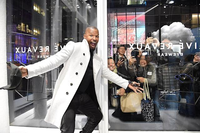 "<p>Foxx looked pretty excited at the opening of the <span>Privé </span>Revaux eyewear store in New York City on Monday. Could it be because his <a href=""https://www.yahoo.com/lifestyle/katie-holmes-quietly-supports-long-064935980.html"" data-ylk=""slk:rumored girlfriend, Katie Holmes"" class=""link rapid-noclick-resp"">rumored girlfriend, Katie Holmes</a>, quietly showed up to the event to support him? (Photo: Kevin Mazur/Getty Images for Prive Reveaux) </p>"
