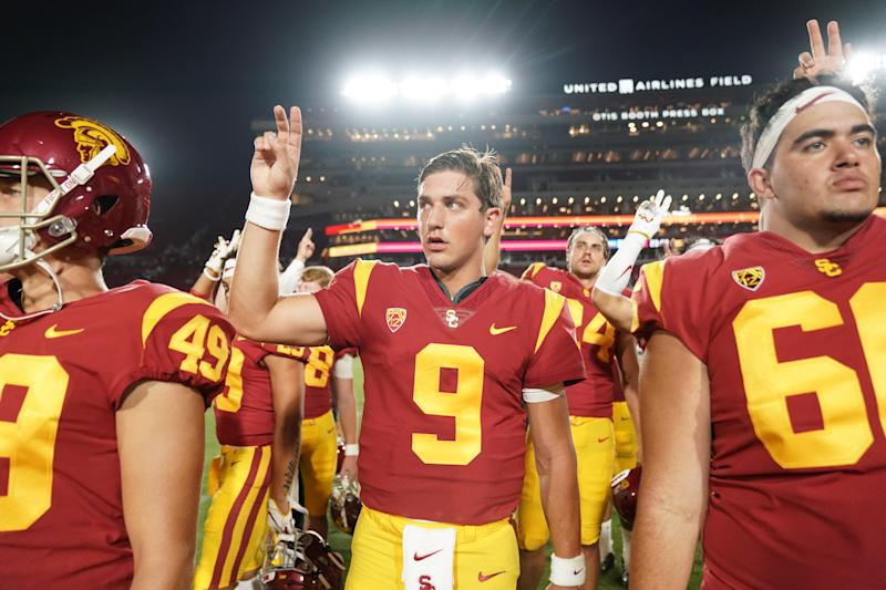 "USC quarterback Kedon Slovis (9) gestures with a ""Fight On"" sign after the Trojans' win over Fresno State. (USAT)"