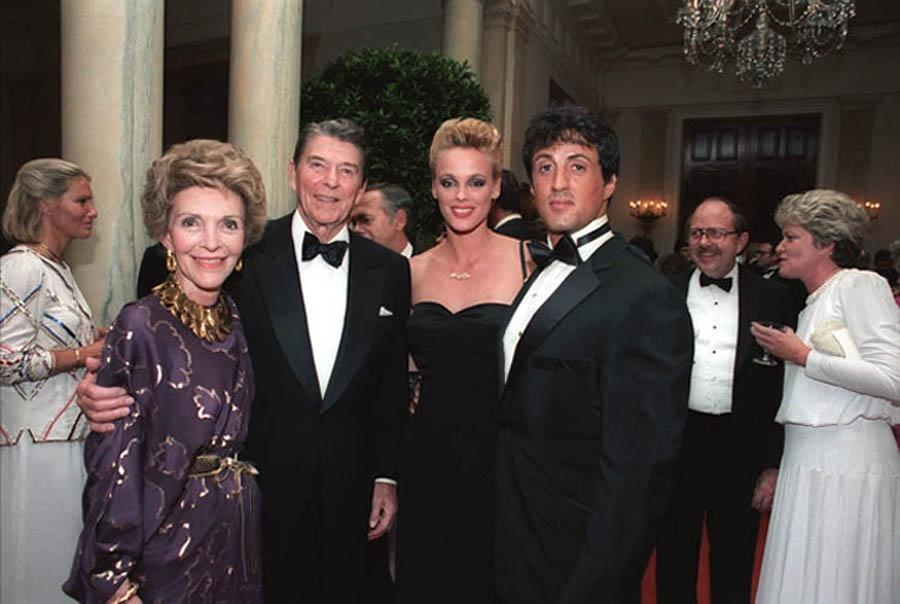 Nancy and Ronald Reagan and Brigitte Nielsen and Sylvester Stallone at a White House State Dinner in 1984. President Reagan often made references to <em>First Blood Part II</em> in various speeches. (Photo: Courtesy Everett Collection)