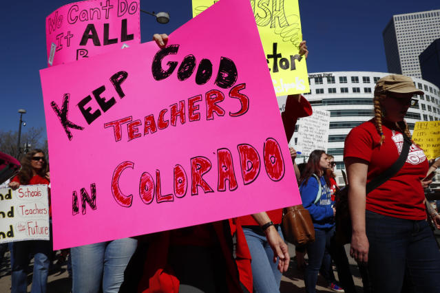 <p>Participants carry placards during a teacher rally, Friday, April 27, 2018, in Denver, Colo. (Photo: David Zalubowski/AP) </p>