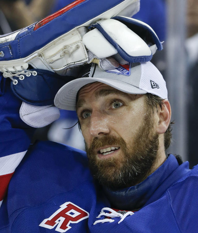 New York Rangers goalie Henrik Lundqvist (30) dons his conference championship hat after beating the Montreal Canadiens 1-0 in Game 6 of the NHL hockey Stanley Cup playoffs Eastern Conference finals, Thursday, May 29, 2014, in New York