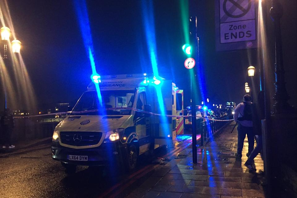 <p>An ambulance on Battersea Bridge after a man was killed</p> (Supplied)