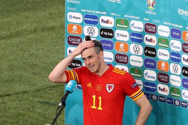 Gareth Bale cannot hide his relief in his post-match interview after 10-man Wales held on to second place in Group A