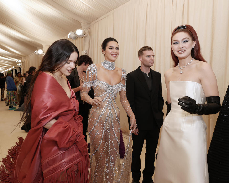 NEW YORK, NEW YORK - SEPTEMBER 13: (L-R) Rosalía, Kendall Jenner and Gigi Hadid attend The 2021 Met Gala Celebrating In America: A Lexicon Of Fashion at Metropolitan Museum of Art on September 13, 2021 in New York City. (Photo by Arturo Holmes/MG21/Getty Images)