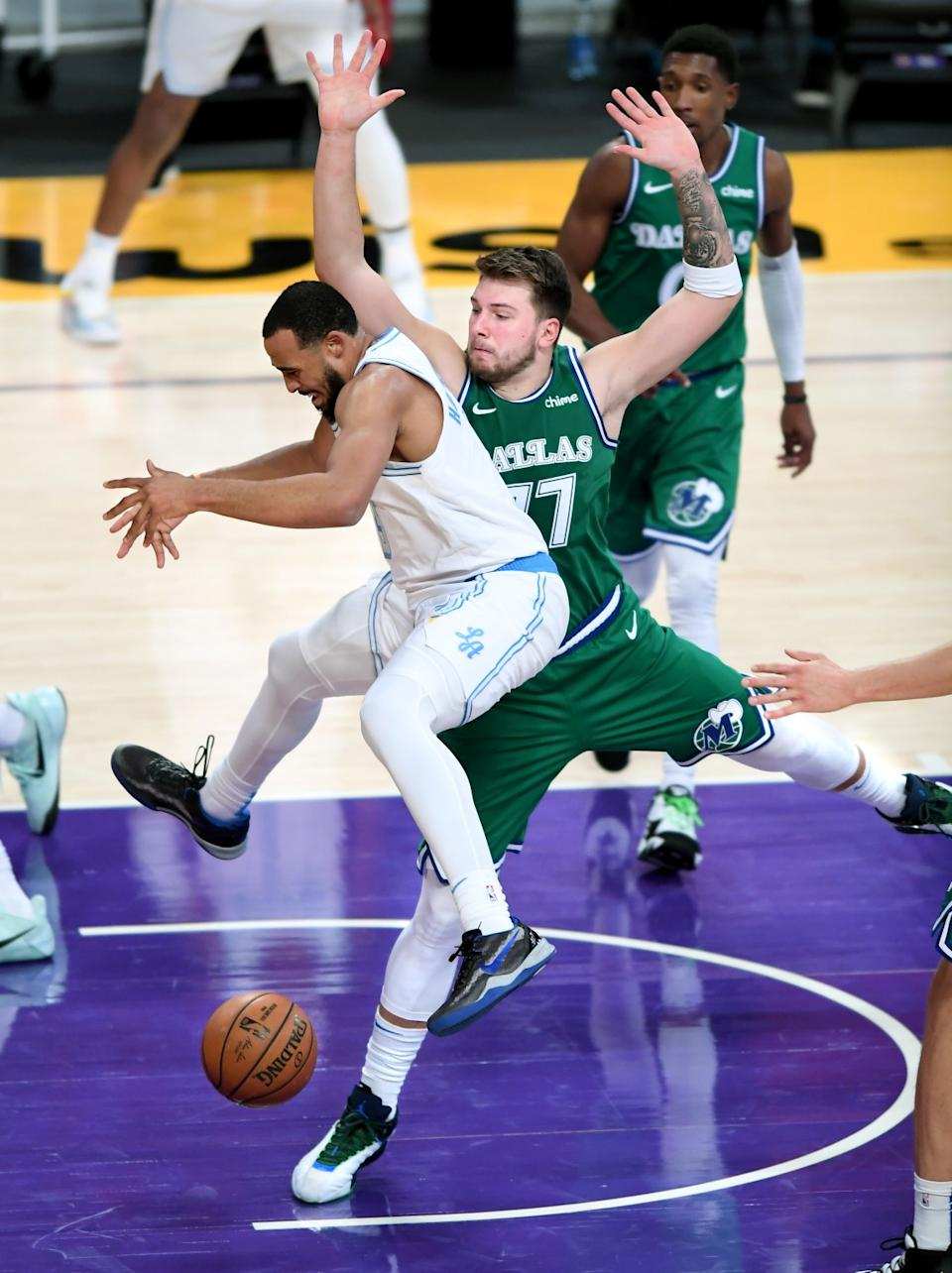 Lakers guard Talen Horton-Tucker loses the ball in front of Mavericks guard Luka Doncic during the second quarter.