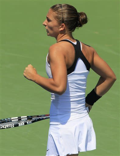 Sara Errani, from Italy, gestures after winning a point against Daniela Hantuchova, from Slovakia, during a match at the Western & Southern Open tennis tournament, Wednesday, Aug. 15, 2012, in Mason, Ohio. (AP Photo/Al Behrman)