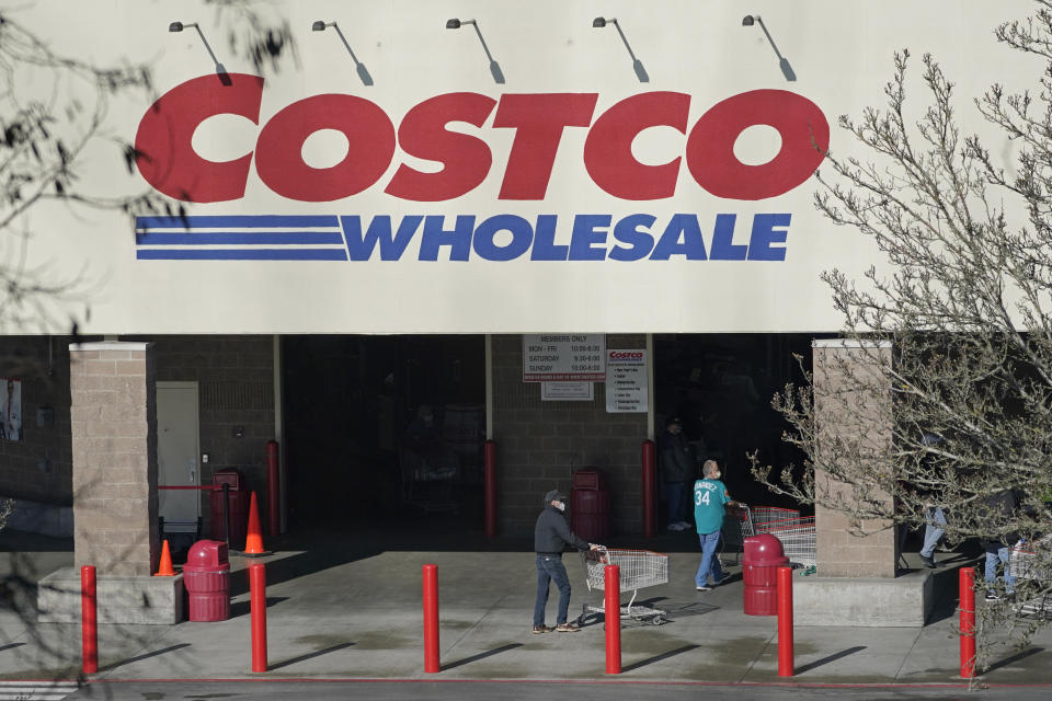 Shoppers walk into a Costco store, Wednesday, March 3, 2021, in Tacoma, Wash. Costco Wholesale Corp. reports earnings results, Thursday, March 4, 2021. (AP Photo/Ted S. Warren)