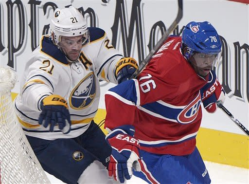 Montreal Canadiens' P.K. Subban, right, skates past Buffalo Sabres' Drew Stafford during first period NHL hockey action in Montreal, Saturday, Feb. 2, 2013. (AP Photo/The Canadian Press, Graham Hughes)
