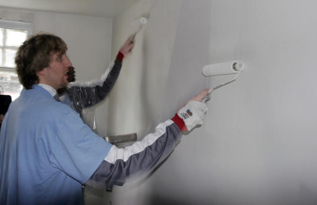 FILE - In this Feb. 15, 2008 file photo, Dallas Mavericks basketball star Dirk Nowitzki, of Germany, paints a wall in a home in the Lower 9th ward of New Orleans. This week marks six years since NBA All-Stars ventured into New Orleans neighborhoods devastated by Hurricane Katrina to lend a hand with rebuilding. (AP Photo/Bill Haber, File)
