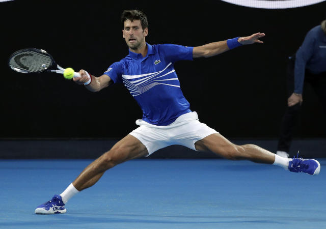 Serbia's Novak Djokovic hits a forehand return to United States' Mitchell Krueger during their first round match at the Australian Open tennis championships in Melbourne, Australia, Tuesday, Jan. 15, 2019. (AP Photo/Kin Cheung)