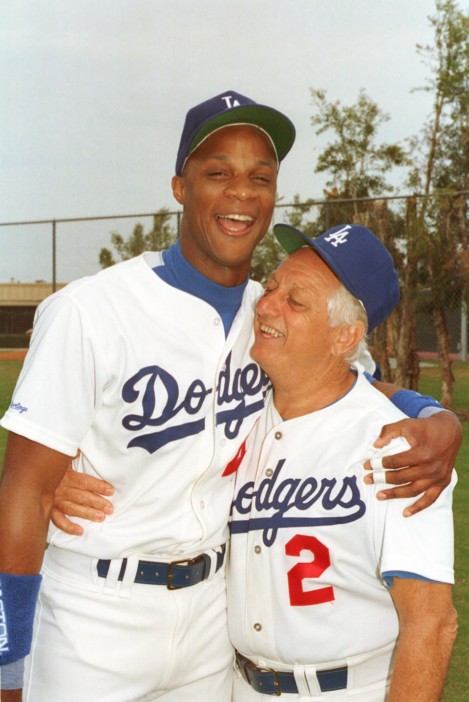 Los Angeles Dodgers manager Tommy Lasorda gives a team welcome to outfielder Darryl Strawberry during spring training at Dodgertown in Vero Beach, Fla., Wednesday morning, Feb. 27, 1991. (AP Photo/Richard Drew)