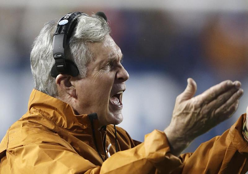 Texas head coach Mack Brown shouts to his team in the second quarter during an NCAA college football game against Brigham Young, Saturday, Sept. 7, 2013, in Provo, Utah. (AP Photo/Rick Bowmer)