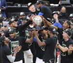 The Milwaukee Bucks celebrate winning the NBA Eastern Conference Finals with the trophy after defeating the Atlanta Hawksin Game 6 of the Eastern Conference finals in the NBA basketball playoffs Saturday, July 3, 2021, in Atlanta. (Curtis Compton/Atlanta Journal-Constitution via AP)