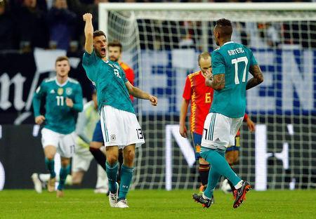 Soccer Football - International Friendly - Germany vs Spain - ESPRIT arena, Dusseldorf, Germany - March 23, 2018 Germany's Thomas Mueller celebrates with Jerome Boateng after scoring their first goal REUTERS/Thilo Schmuelgen