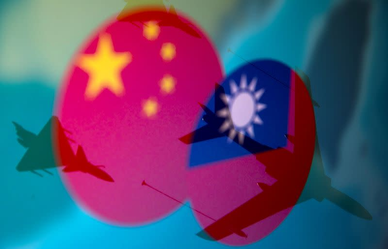 FILE PHOTO: Chinese, Taiwanese flags and military airplanes displayed in this illustration
