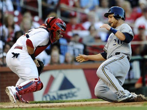Milwaukee Brewers' Jonathan Lucroy (20) scores on a hit by Mike Fiers as St. Louis Cardinals catcher Yadier Molina, left, cannot make the tag in the second inning of a baseball game, Saturday, Sept. 8, 2012, at Busch Stadium in St. Louis. (AP Photo/Bill Boyce)