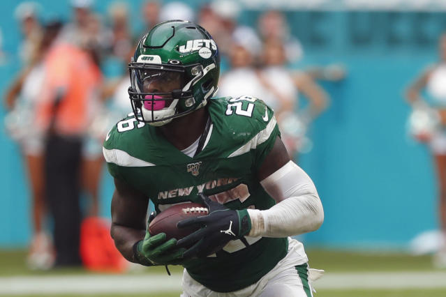 FILE - In this Sunday, Nov. 3, 2019, file photo, New York Jets running back Le'Veon Bell (26) runs during the second half of an NFL football game against the Miami Dolphins, in Miami Gardens, Fla. Bell had an MRI on one of his knees, and the Jets are awaiting the results to see if the star running back will need to miss any time. Coach Adam Gase says Monday, he's unsure when Bell was injured during New York's 26-18 loss at Miami on Sunday. Gase learned of it Monday morning when Bell had to miss team meetings to undergo the tests.(AP Photo/Wilfredo Lee, File)