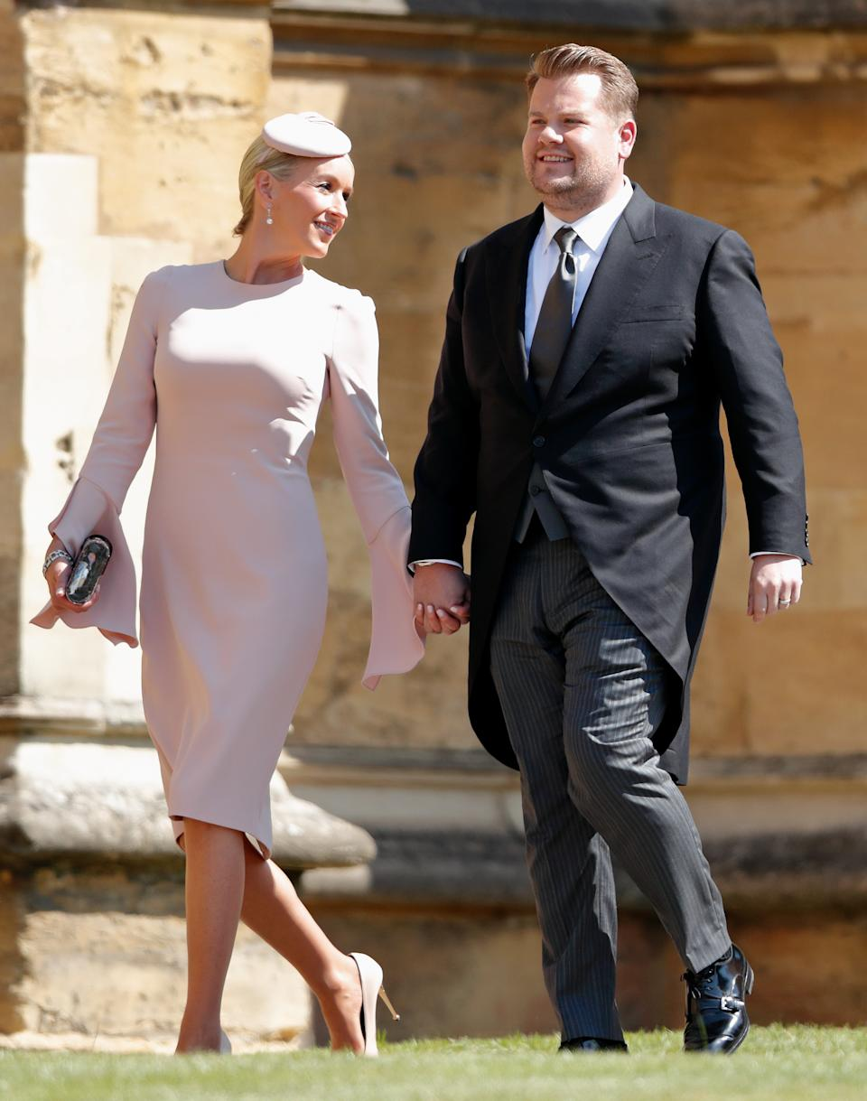 WINDSOR, UNITED KINGDOM - MAY 19: (EMBARGOED FOR PUBLICATION IN UK NEWSPAPERS UNTIL 24 HOURS AFTER CREATE DATE AND TIME) Julia Carey and James Corden attend the wedding of Prince Harry to Ms Meghan Markle at St George's Chapel, Windsor Castle on May 19, 2018 in Windsor, England. Prince Henry Charles Albert David of Wales marries Ms. Meghan Markle in a service at St George's Chapel inside the grounds of Windsor Castle. Among the guests were 2200 members of the public, the royal family and Ms. Markle's Mother Doria Ragland. (Photo by Max Mumby/Indigo/Getty Images)
