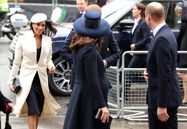 Meghan Markle makes her way into the service behind Prince William, the Duke of Cambridge, and his wife, Catherine, Duchess of Cambridge.