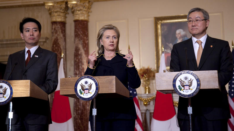 Secretary of State Hillary Clinton, center, gestures during a news conference with Japanese Foreign Minister Seiji Maehara, left, and South Korean Foreign Minister Kim Sung-hwan, Monday, Dec. 6, 2010, at the State Department in Washington.  (AP Photo/Evan Vucci)