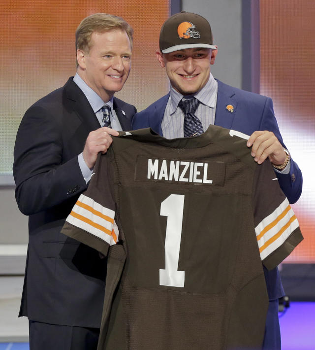 Texas A&M quarterback Johnny Manziel poses with NFL commissioner Roger Goodell after being selected by the Cleveland Browns as the 22nd pick in the first round of the 2014 NFL Draft, Thursday, May 8, 2014, in New York. (AP Photo/Frank Franklin II)