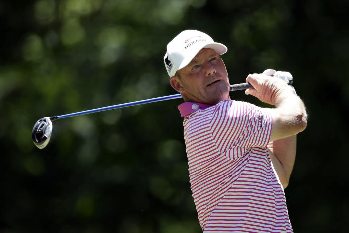FILE - Alex Cejka, of Germany, tees off on the seventh hole during the final round of the Regions Tradition Champions Tour golf tournament in Hoover, Ala., in this Sunday, May 9, 2021, file photo. The PGA Tour Champions newcomer already has wins in two senior majors and will go for a third this week in the U.S. Senior Open at Omaha Country Club. (AP Photo/Butch Dill, File)