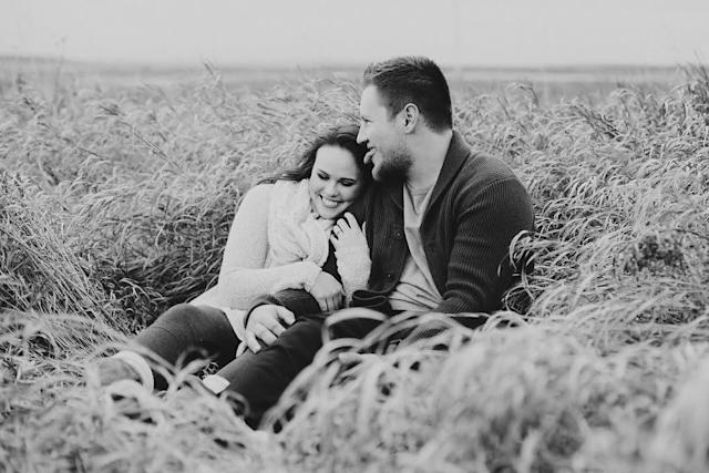 """When I planned this photo shoot, I had imagined us looking romantically into each other's eyes in the middle of this vast field. As the photographer posed us and directed us and asked us to fake laugh, he had to break the stiffness by sticking his tongue out in the middle of this """"picture-perfect"""" moment,giving me themost genuine laugh when I later saw the photo. There have been so many times I imagined a perfect vacation or date night or move-in and it hasn't gone as planned. But he is always there being silly and making me smile. I've fallen madly in love with every imperfect moment we've spent together because it's somehow even better than what I imagined. -- <i>Aimee B.</i>"""