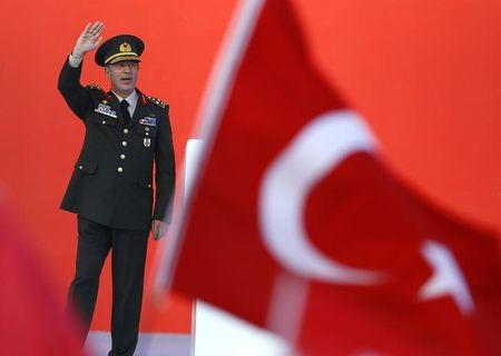 Turkey's Chief of the General Staff Akar greets audience during the Democracy and Martyrs Rally in Istanbul