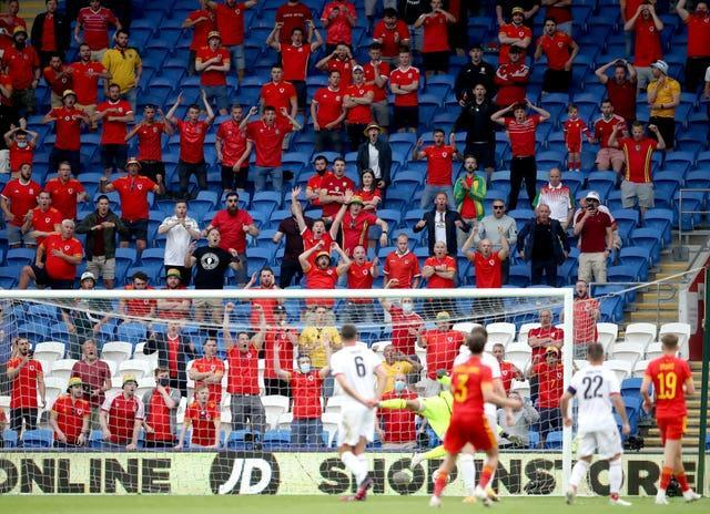 Wales fans react as Neco Williams has a shot at goal