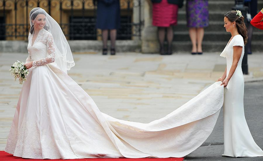 Pippa Middleton holding the 9-foot-train on Kate Middleton's Alexander McQueen wedding dress. (Photo: Getty Images)