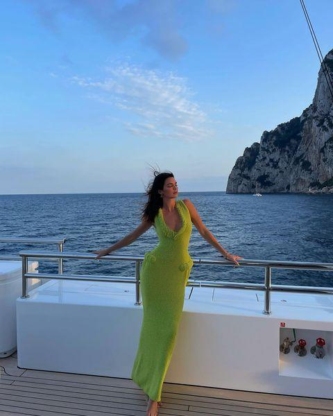 """<p>While on holiday with beau <a href=""""https://www.elle.com/uk/life-and-culture/a35505580/kendall-jenner-boyfriend/"""" rel=""""nofollow noopener"""" target=""""_blank"""" data-ylk=""""slk:Devin Booker in Italy"""" class=""""link rapid-noclick-resp"""">Devin Booker in Italy</a>, Kendall Jenner stepped into an apple green terry cloth gown by Bottega Veneta pairing it with Monica Vinader's Alta Capture bracelet.</p><p><a class=""""link rapid-noclick-resp"""" href=""""https://go.redirectingat.com?id=127X1599956&url=https%3A%2F%2Fwww.monicavinader.com%2Falta-capture-charm-bracelet%2Fgold-vermeil-alta-capture-charm-bracelet&sref=https%3A%2F%2Fwww.elle.com%2Fuk%2Ffashion%2Fcelebrity-style%2Farticles%2Fg2543%2Fkendall-jenner%2F"""" rel=""""nofollow noopener"""" target=""""_blank"""" data-ylk=""""slk:SHOP KENDALL'S BRACELET HERE"""">SHOP KENDALL'S BRACELET HERE</a></p><p><a href=""""https://www.instagram.com/p/CS-ABhdnK8q/"""" rel=""""nofollow noopener"""" target=""""_blank"""" data-ylk=""""slk:See the original post on Instagram"""" class=""""link rapid-noclick-resp"""">See the original post on Instagram</a></p>"""