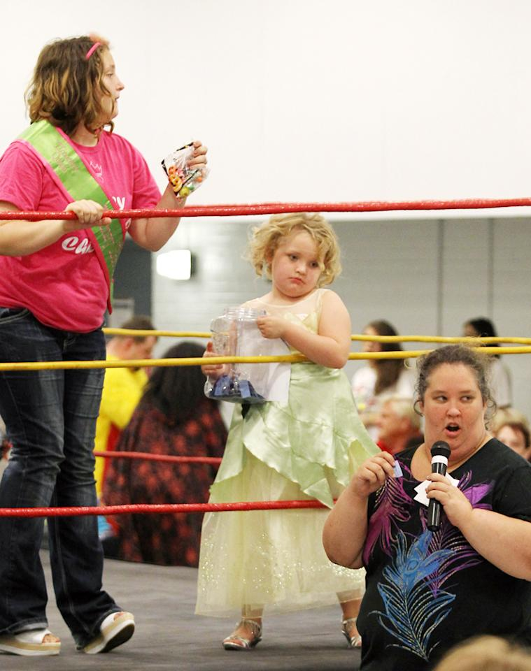 "The stars of ""Here Comes Honey Boo Boo"" -- Alana ""Honey Boo Boo"" Thompson, her big sis, Lauryn ""Pumpkin"" Shannon, and their mom, June Shannon -- redneckognized an opportunity to get a little attention at a wrestling match in Milledgeville, Georgia. (10/9/12)"
