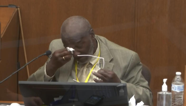 In this image from video, witness Charles McMillian becomes emotional as he answers questions as Hennepin County Judge Peter Cahill presides Wednesday, March 31, 2021, in the trial of former Minneapolis police Officer Derek Chauvin at the Hennepin County Courthouse in Minneapolis, Minn. Chauvin is charged in the May 25, 2020 death of George Floyd. (Court TV via AP, Pool)