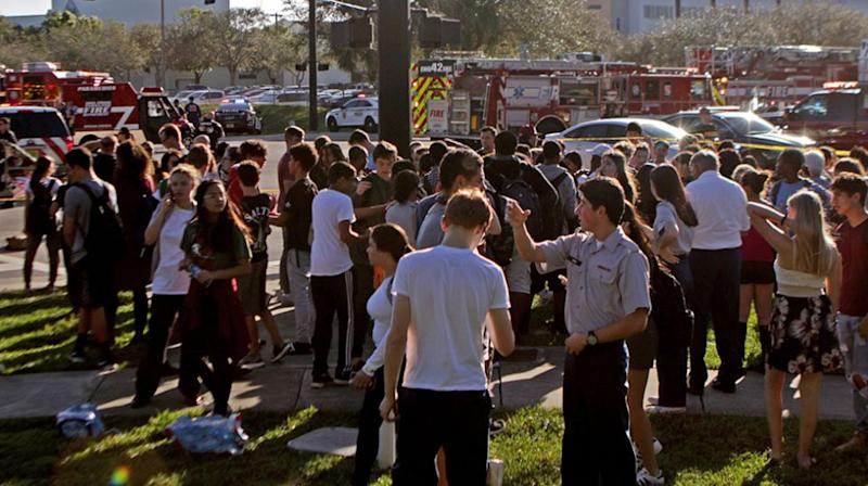 Students gather outside the school after the suspect was taken into custody. Source: Getty