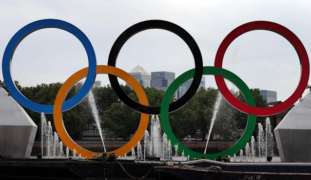 Olympic rings with cycle powered fountains are installed on The River Thames at Greenwich on August 1, 2012 in Greenwich, England. (Photo by Peter Macdiarmid/Getty Images)