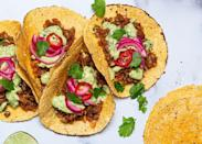 """<p>These vegan tacos are loaded with bright flavours and a variety of textures—just like any good taco should be! Serve them up with some <a href=""""https://www.delish.com/uk/cocktails-drinks/a33441209/frozen-blue-moscato-margaritas-recipe/"""" rel=""""nofollow noopener"""" target=""""_blank"""" data-ylk=""""slk:frozen margaritas"""" class=""""link rapid-noclick-resp"""">frozen margaritas</a> and <a href=""""https://www.delish.com/uk/cooking/recipes/a29947768/best-ever-guacamole-recipe/"""" rel=""""nofollow noopener"""" target=""""_blank"""" data-ylk=""""slk:homemade guacamole"""" class=""""link rapid-noclick-resp"""">homemade guacamole</a> for the full Taco Tuesday experience. </p><p>Get the <a href=""""https://www.delish.com/uk/cooking/recipes/a33542524/vegan-tacos-recipe/"""" rel=""""nofollow noopener"""" target=""""_blank"""" data-ylk=""""slk:Vegan Chipotle Lentil Tacos"""" class=""""link rapid-noclick-resp"""">Vegan Chipotle Lentil Tacos</a> recipe. </p>"""