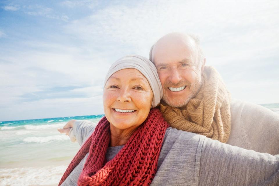 Mature man and woman on beach