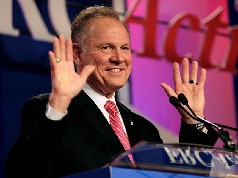 Roy Moore, seen here speaking at the Values Voter Summit of the Family Research Council in Washington, DC on October 13, 2017, faces allegations of pursuing relationships with underage women (REUTERS/James Lawler Duggan)