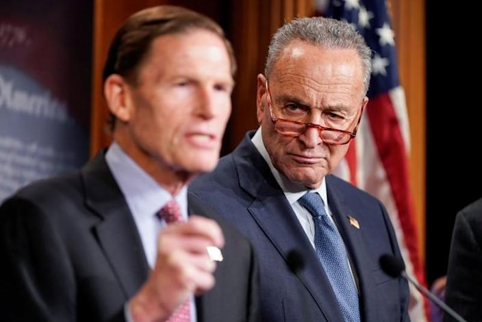 Senatord Blumenthal and Schumer speak to journalists after start of Trump impeachment trial on Capitol Hill in Washington