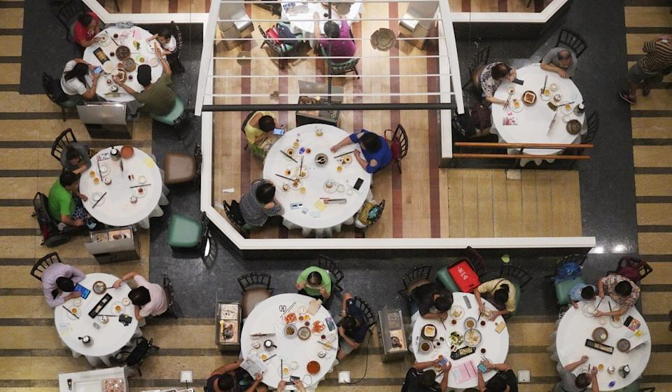 Six people can sit together at restaurant tables, up from four. Photo: Winson Wong
