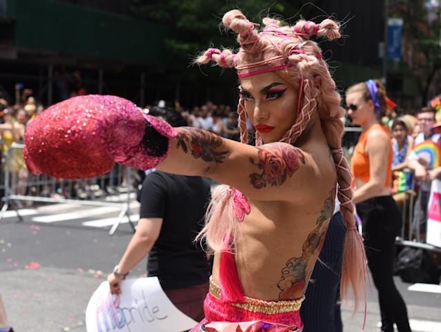 <p>People take part in the annual 2018 New York City Pride Parade on June 24, 2018 as they make their way down 7th Avenue in New York. (Photo: Timothy A. Clary/AFP/Getty Images) </p>