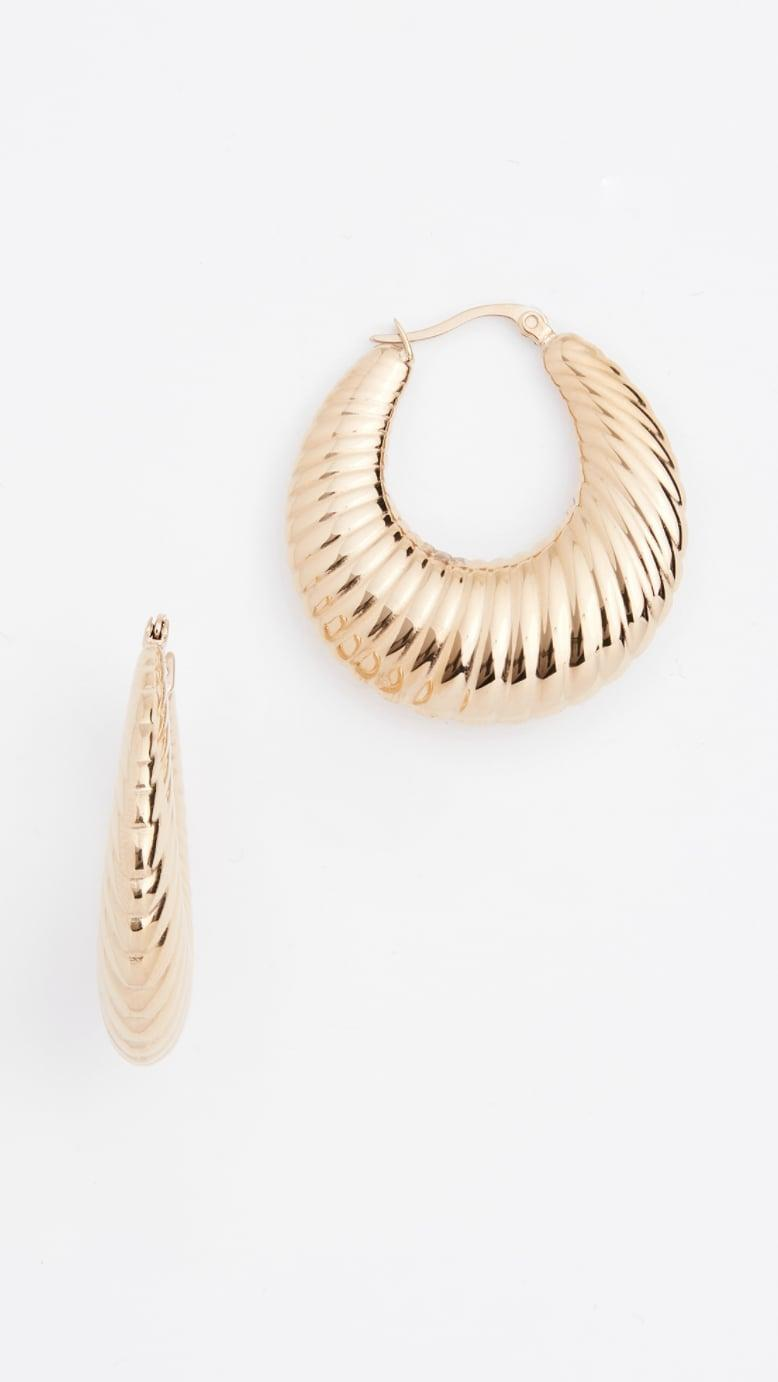 <p>We particularly love the texture of these <span>Shashi Sadie Hoop Earrings</span> ($55), plus the simple style makes them easy to pair with everything.</p>