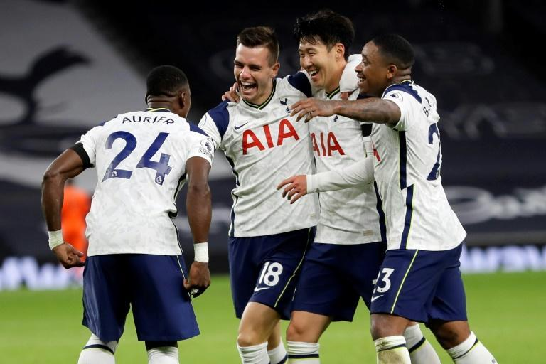 Happy Spurs: Tottenham players celebrate Giovani Lo Celso's (second left) second goal in a 2-0 win over Manchester City