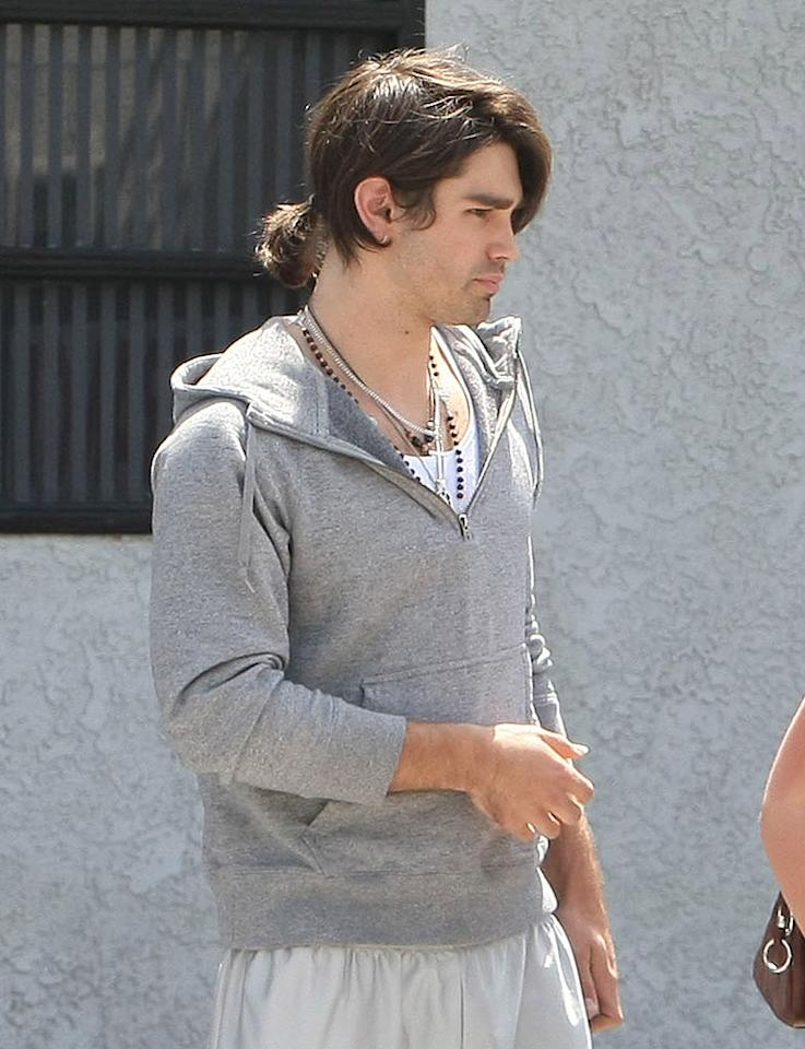 "It's not just Hollywood starlets that sported questionable coifs. Justin Gaston's (Miley Cyrus' boyfriend) hair has gotten so long that he now wears it in a ponytail. Stefan/<a href=""http://www.infdaily.com"" target=""new"">INFDaily.com</a> - April 29, 2009"