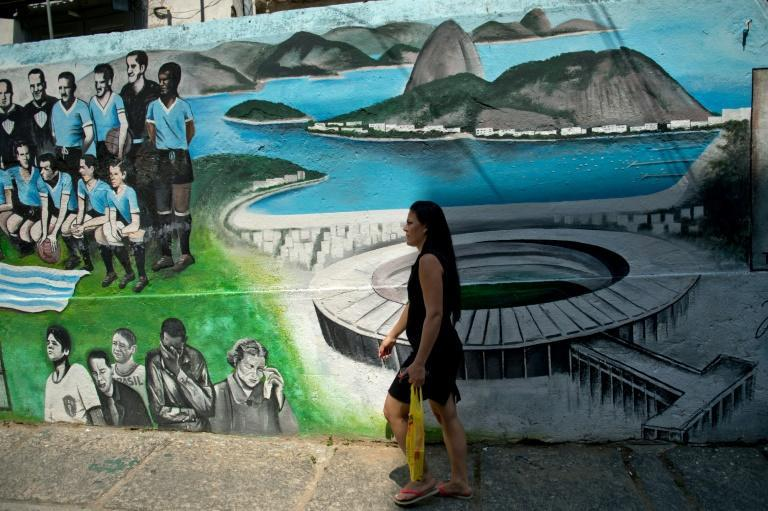 A mural in Rio de Janeiro by artist Jambeiro depicting the 'Maracanazo' when Uruguay's victory sent a nation into mourning (AFP Photo/Christophe SIMON)