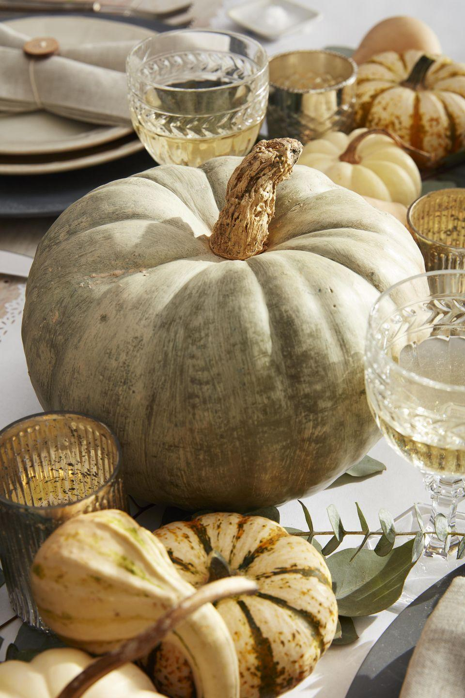 """<p>Five minutes and done! Paint a green or tan heirloom pumpkin with off-white acrylic paint and voila. Sophistication!</p><p><a class=""""link rapid-noclick-resp"""" href=""""https://www.amazon.com/Delta-Creative-Ceramcoat-Acrylic-Assorted/dp/B00A2CHV76/ref=sr_1_1?tag=syn-yahoo-20&ascsubtag=%5Bartid%7C10050.g.1371%5Bsrc%7Cyahoo-us"""" rel=""""nofollow noopener"""" target=""""_blank"""" data-ylk=""""slk:SHOP PAINT"""">SHOP PAINT</a><br></p>"""