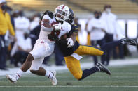 Stanford running back Nathaniel Peat carries as California safety Elijah Hicks defends during the second half of an NCAA college football game Friday, Nov. 27, 2020, in Berkeley, Calif. (AP Photo/Jed Jacobsohn)