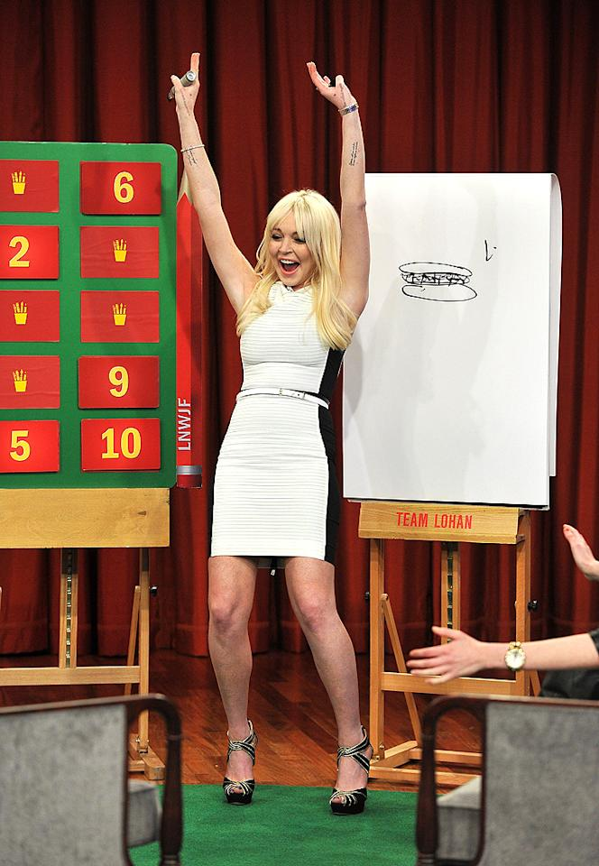 "NEW YORK, NY - MARCH 01:  Lindsay Lohan plays a game of Pictionary during a taping of ""Late Night With Jimmy Fallon"" at Rockefeller Center on March 1, 2012 in New York City.  (Photo by Theo Wargo/NBCUniversal/Getty Images)"