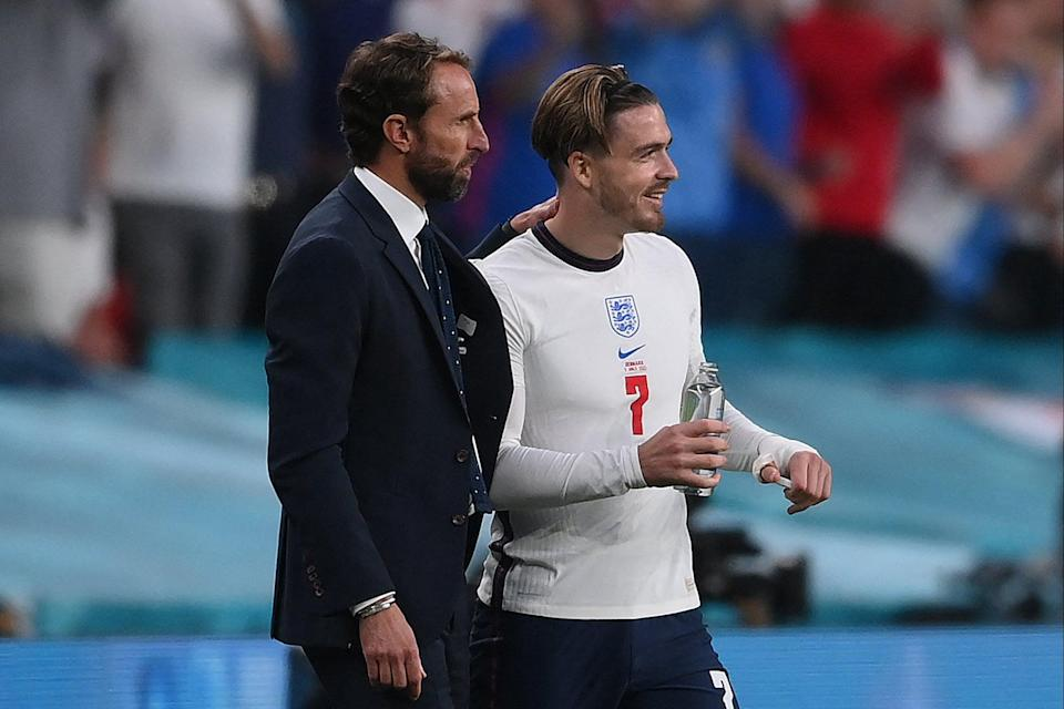 Gareth Southgate speaks with  Jack Grealish before being substituted (POOL/AFP via Getty Images)